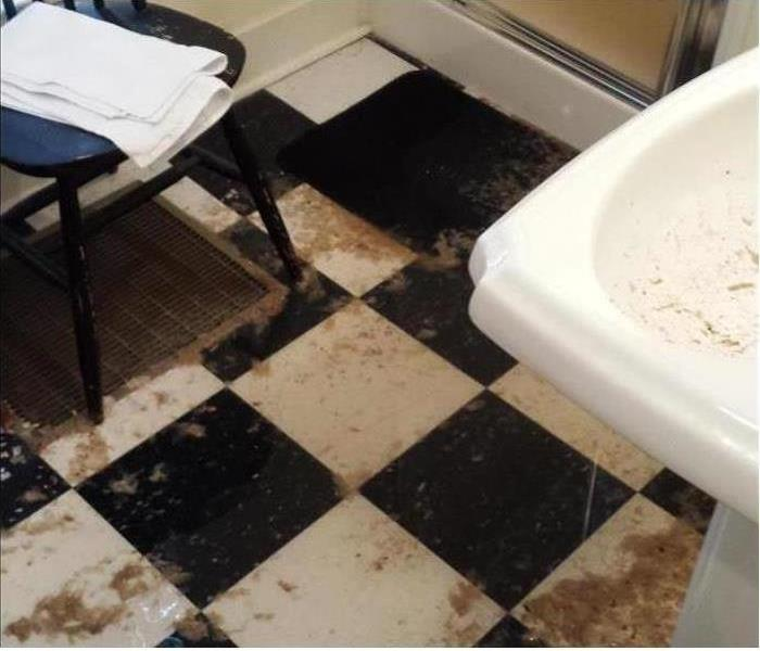 Sewage water on bathroom floor