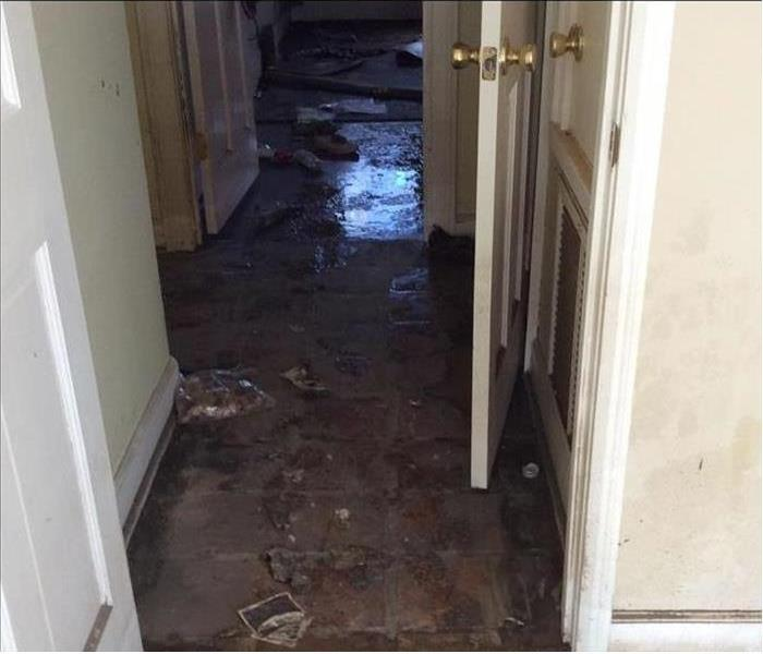 flooded hallway after storm