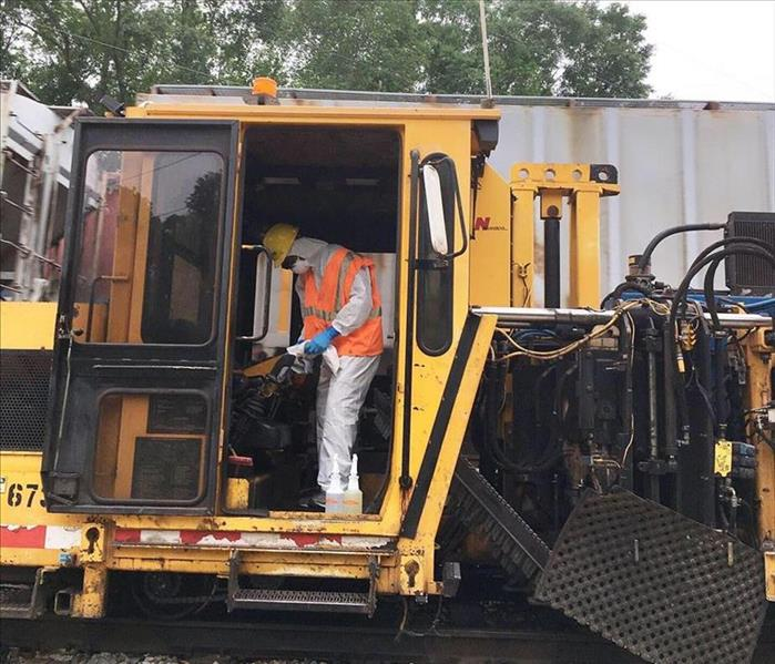 workers cleaning and sanitizing railroad utility vehicles