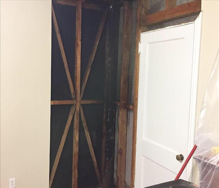 Wall removed due to water damage from Lightning Storm