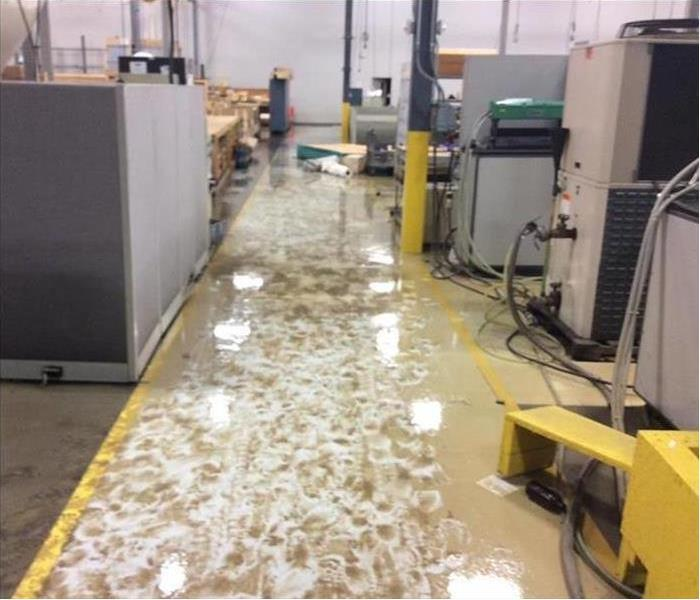 flooded commercial building floors after flood